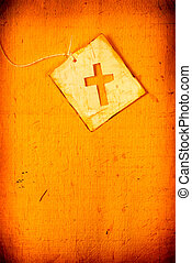 holy cross - Close up of handmade paper tag with holy cross