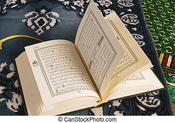 Holy Koran - Open Koran on a praying carpet