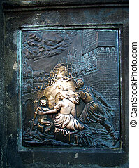 Digital photo of a bronze-board on the Karls-bridge in prague. It shows how the holy johannes v. nepomuk (famous priest) was thrown into the river Moldau. The legend says, when you touch it and later on the bridge touch a cross you will have good luck. Travel to prague and try it!