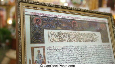RADEHIV, UKRAINE - MAR 12, 2021: Holy scriptures with ancient texts are located in the center of orthodox church. Spiritual relic
