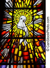 Holy Spirit Dove Symbol - Stained glass of white dove in a...