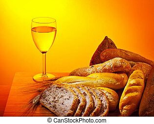 Holy supper, communion dinner, bread and glass of wine, ...