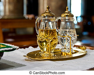 holy water and holy wine ready for mass