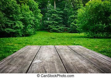 holztisch, mit, grün, natur, hintergrund