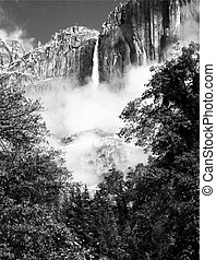 Black and white photo of Upper Yosemite Falls in Yosemite Valley, CA, in the style of Ansel Adams