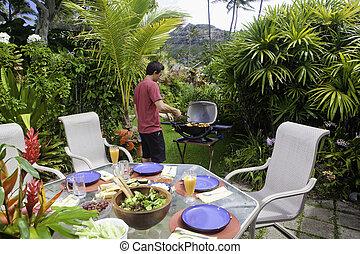 hombre asiático, cocina, en, un, barbacoa