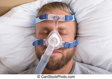 hombre, con, sueño, apnea, y, cpap, máquina