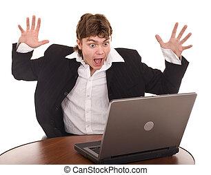 hombre de negocios, con, computador portatil, en, oficina.