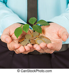 hombre de negocios, cubierta, crecer, planta, con, moneda, dinero
