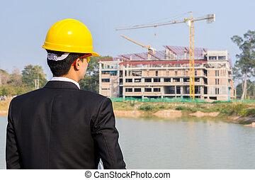 hombre de negocios, el mirar, edificio, con, crane.