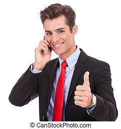 hombre de negocios, hablar, en, el, elegante, teléfono, y,...