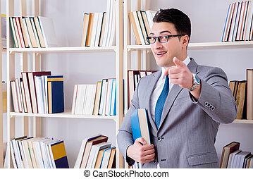hombre de negocios, lectura del estudiante, un, libro, estudiar, en, biblioteca