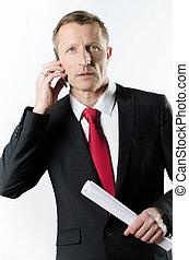 hombre de negocios, por teléfono