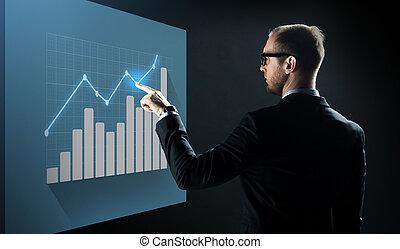 hombre de negocios, señalar el dedo, a, virtual, gráfico