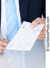 hombre de negocios, tenencia, cheque