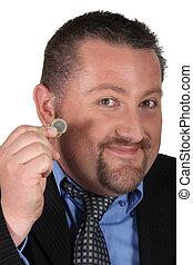 hombre de negocios, tenencia, dos euro, coins