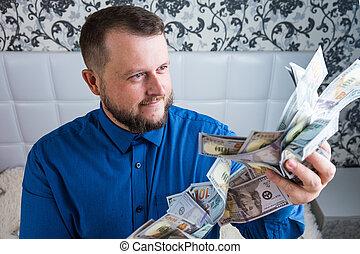 hombre, dinero., dólares., riqueza, macho, asideros, manos, terreno, goza, el suyo, concepto, efectivo, tremendo