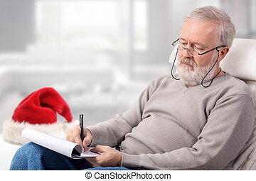 hombre, elaboración, el, lista de compras, para, vacaciones, al lado de, un, sombrero rojo