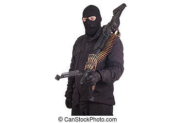 hombre, en, uniformes negros, con, ametralladora