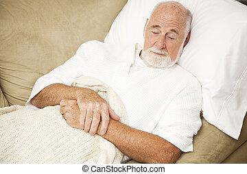 hombre mayor, duerme, en, sofá