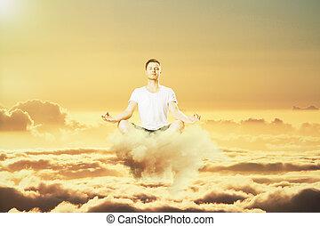 hombre, meditación, en las nubes, concepto