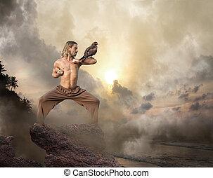 hombre, prácticas, artes marciales, con, ave de rapiña, en, amanecer