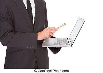 hombre, tenencia, computador portatil, y, lupa