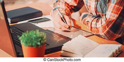 hombre, trabajando, tableta, gráficos