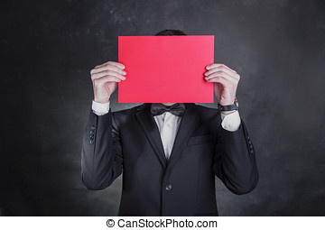 hombre, usa, esmoquin negro, asideros, papel, delante de, face.