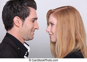 hombre y mujer, posición, cara a cara