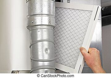 Home Air Filter Replacement - Male arm and hand replacing...
