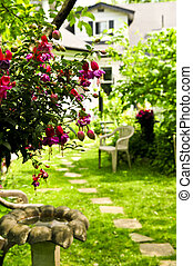 Home and garden - Path of stepping stones leading to a house...