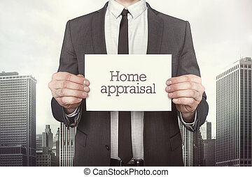Home appraisal on paper what businessman is holding on cityscape background