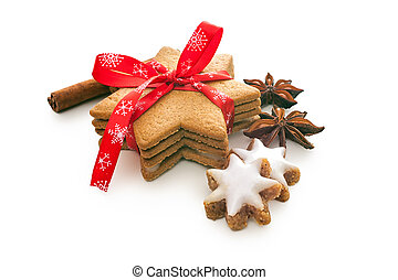 home baked christmas cookies on white with red ribbon