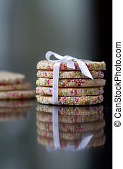 Tower of home baked cookies tied with a ribbon