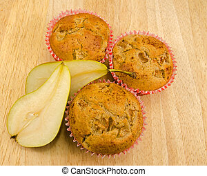 Home baked Pear muffins on chopping board