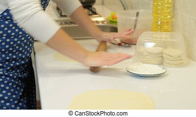 Home Baking - Female Hands Rolls Out Dough For Pies On ...