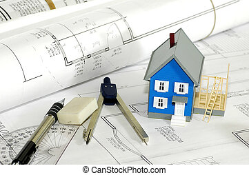 Miniature House With Various Drafting Items and Plans.