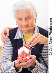 Home care - Photo of a miniature house holding in hands