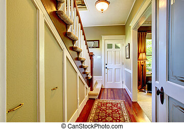 Home classsic decor hallway with entrance front door.
