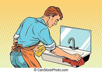 Home cleaning washing kitchen sinks, man works