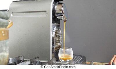 Home coffee machine pouring espresso