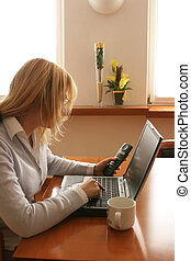 home connection - woman working at the computer at home