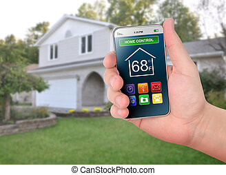 Home Control Smart Phone Monitoring - A smart phone is in ...