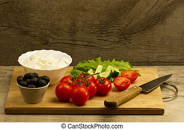 Home cooking summer Greek salad on wooden background