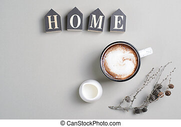 Home Cozy Concept with Cup of Coffee with Cream on Bright Beige Background