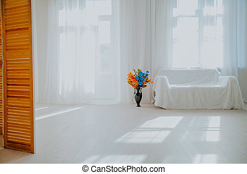 home decor white room with sofa and flowers in a vase