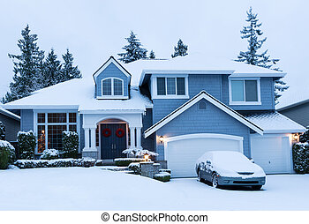 Home decorated for the winter holidays with fresh snow