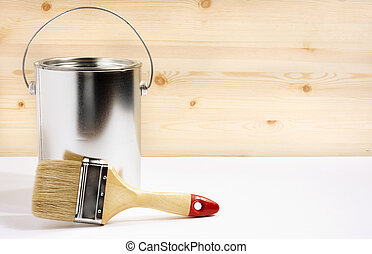 home decorating concept - brush and metal can with paint, ...