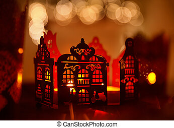 Home Decoration in Candle Light, Christmas Abstract Lighting House Decor over De Focused Lighting Background